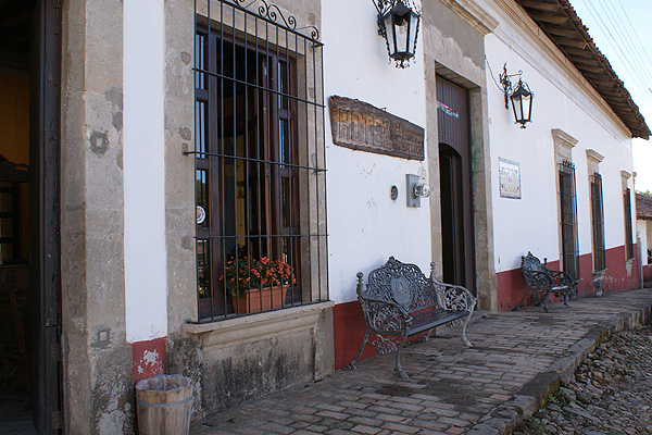 Main street and entrance to one of the first hotels in San Sebastian del Oeste. Photo by Harvest Estudio